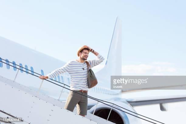 man disembarking a flight - disembarking stock pictures, royalty-free photos & images
