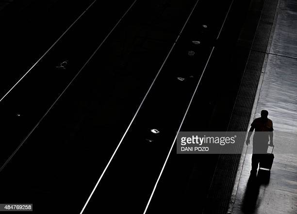 A man disembarks from a train at Madrid's Atocha station on August 21 2015 AFP PHOTO / DANI POZO / AFP / DANI POZO