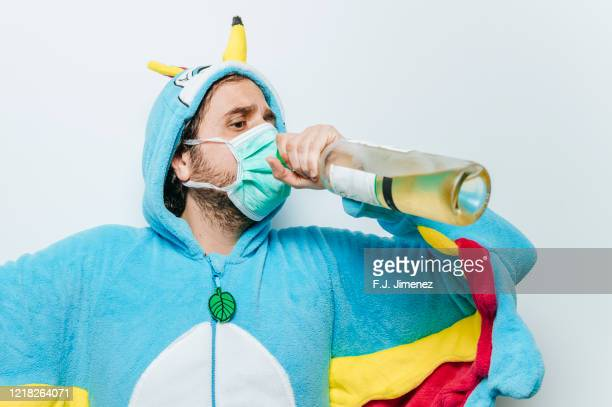 man disguised as chicken and wearing a mask and wine - funny surgical mask stock pictures, royalty-free photos & images