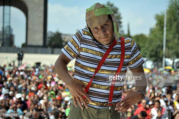 A man disguised as famous Latin American TV character El Chavo del Ocho starred by Mexican artist Roberto Gomez Bolaños aka Chespirito takes part in...