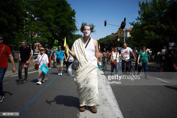 A man disguised as Jupiter the Greek god pretends to imitate French President Macron as he's nicknamed 'Jupiter' A quotmaree populairequot...