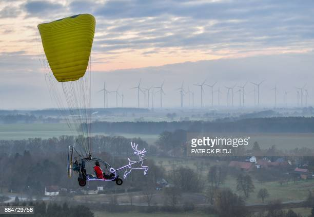 Man, disguised as Santa Claus, flies in a microlight on December 2, 2017 near Sieversdorf, eastern Germany. - - Germany OUT / Germany OUT