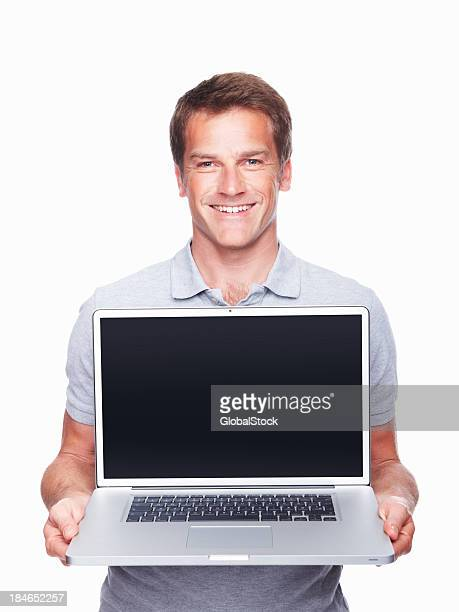 Man displaying laptop