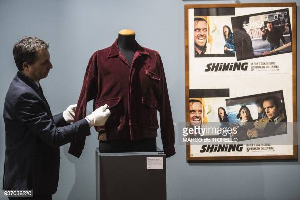 A man displays a burgundy corduroy jacket worn by Jack Nicholson on the set of the movie The Shining from the collection Cinema Stanley Kubrick at...