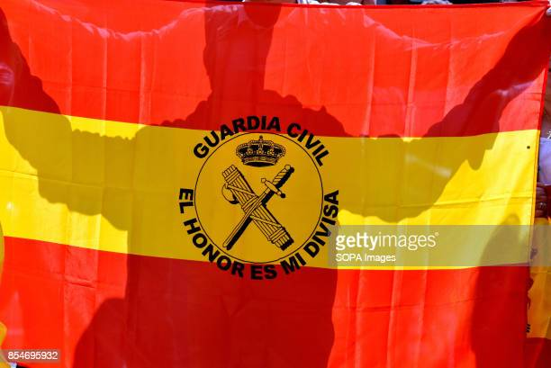 RàDIO BARCELONA CATALONIA SPAIN A man displays a flag of Spain with the coat of arms of the Spanish Civil Guard police Around 50 demonstrators from...