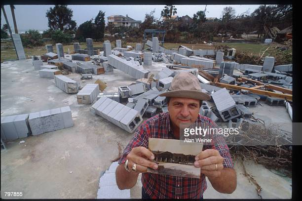 A man displays a photograph of his house taken before the hurricane destroyed it September 27 1989 in South Carolina Hugo is ranked as the eleventh...