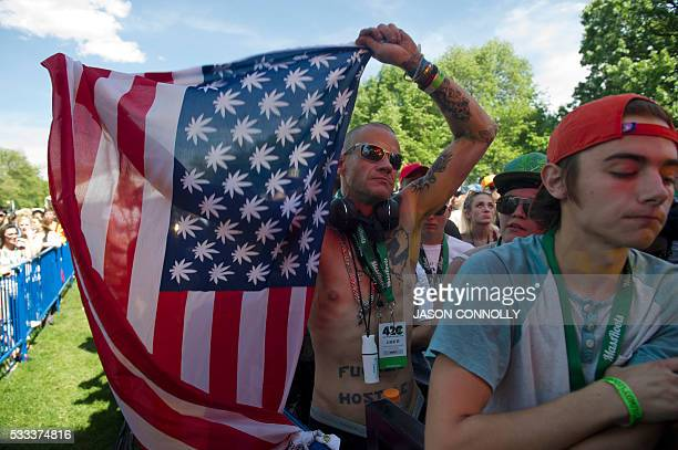 A man displays a promarijuana US flag during the Denver 420 Rally the world's largest celebration of both the legalization of cannabis and cannabis...