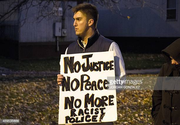 A man displays a sign during a rally at Cudell Commons Park in Cleveland Ohio November 24 2014 where Tamir Rice a 12yearold boy was shot by police on...