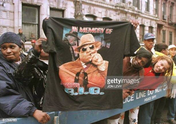 A man displays a Tshirt tribute to rapper Biggie Smalls aka The Notorious BIG 18 March as friends and fans lined the funeral procession route through...