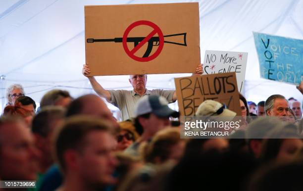 A man displays an anti gun violence sign during a March for our Lives Rally at Fairfield Hills Campus in Newtown Connecticut on August 12 2018