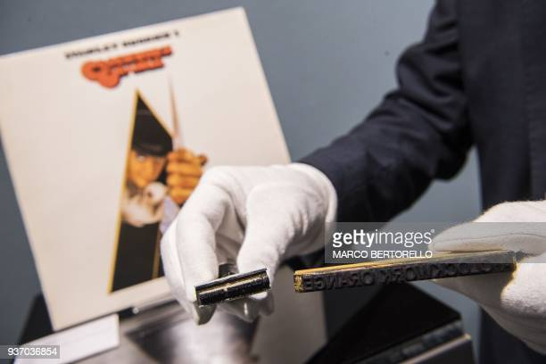 A man displays objects from the movie A Clockwork Orange from the collection Cinema Stanley Kubrick at the Aste Bolaffi auction house in Turin on...