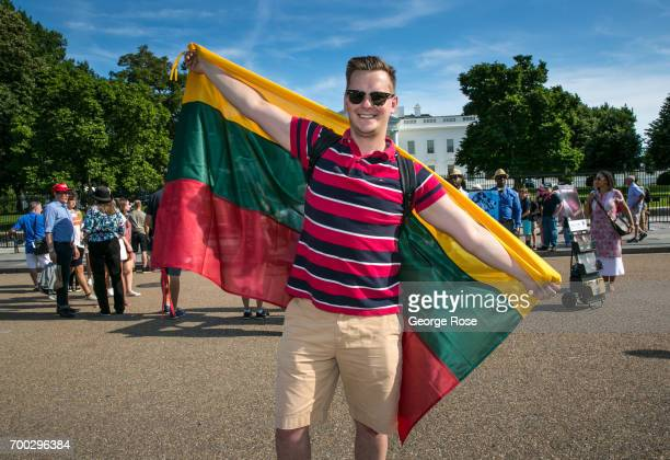 A man displays the Lithuanian flag in front of The White House on June 4 2017 in Washington DC The nation's capital the sixth largest metropolitan...