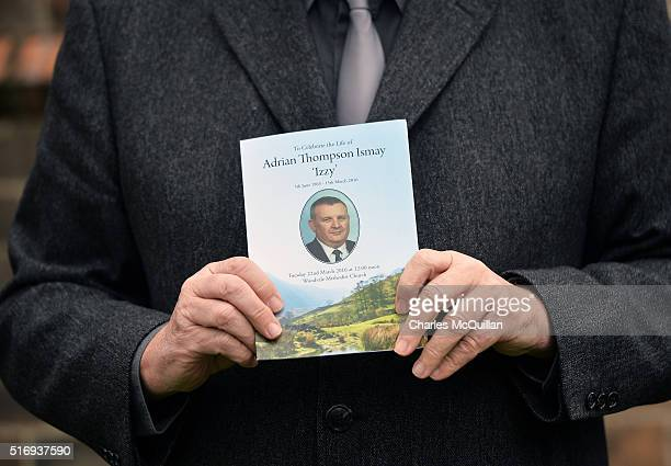 A man displays the order of service as the funeral of murdered prison officer Adrian Ismay takes place on March 22 2016 in Belfast Northern Ireland...