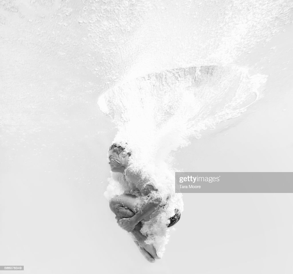 man dive bombing into water : Stock Photo