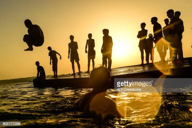TOPSHOT A man dives in the sea on the beach at Menekse on July 2 in Istanbul Turkey was sweltering in a weekend heatwave that caused record...
