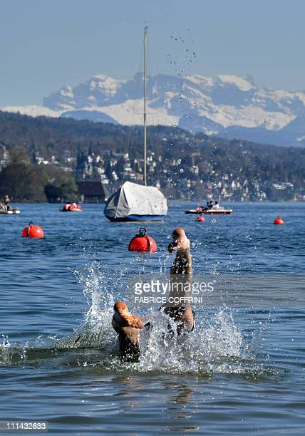 A man dives into Lake Zurich as unusual warm spring temperatures hit Switzerland on April 2 2011 in Zurich AFP PHOTO / FABRICE COFFRINI