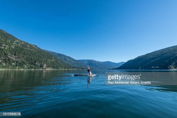 man dives into mountain lake - british columbia bildbanksfoton och bilder