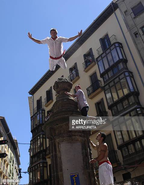 A man dives into the crowd 06 July 2007 suring the Chupinazo the beginning of the San Fermin Fair where more than a million people are expected...