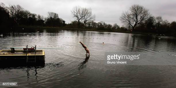 Man dives into the Hampstead Heath men?s swimming pond, February 21, 2005 in London, England. The future of the north London ponds, which an...