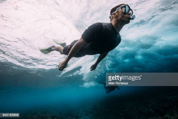 Man diving below the waves