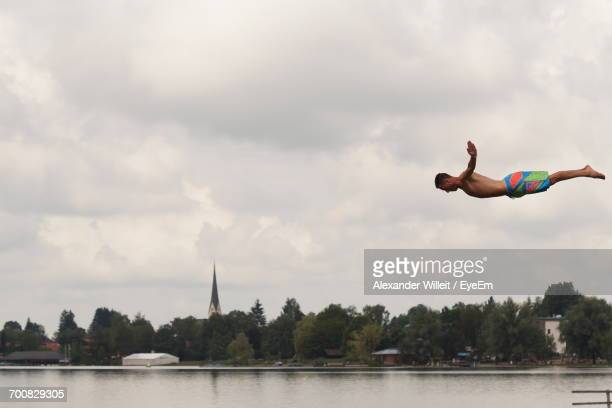 Man Diving In Lake