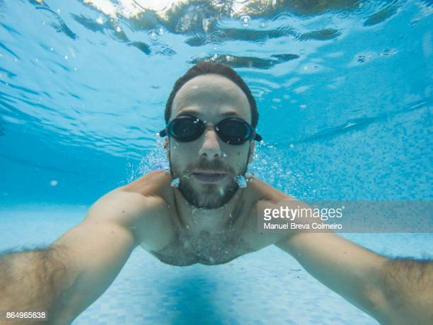 man diving in the pool - castellon province stock pictures, royalty-free photos & images
