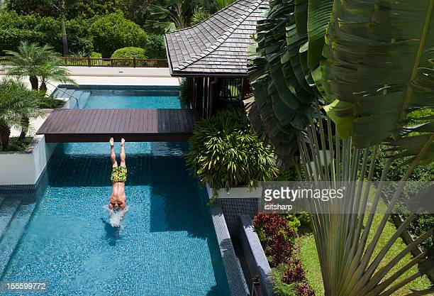 Man diving in to a swimming pool