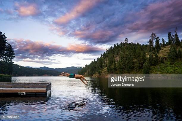 A man diving into a lake.