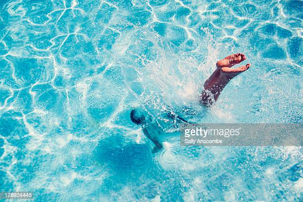 Man diving into a swimming pool
