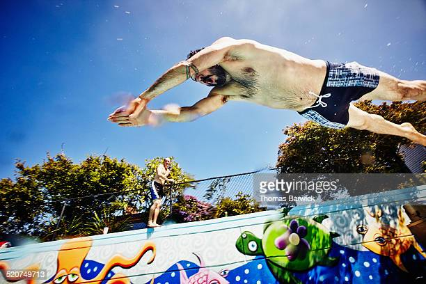 Man diving into outdoor swimming pool