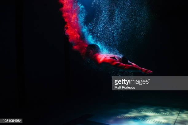 man diving into pool - underwater stock pictures, royalty-free photos & images