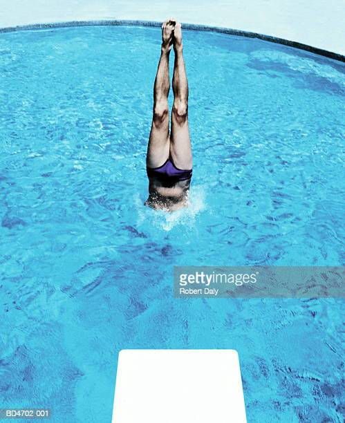 man diving into swimming pool - young men in speedos stock photos and pictures
