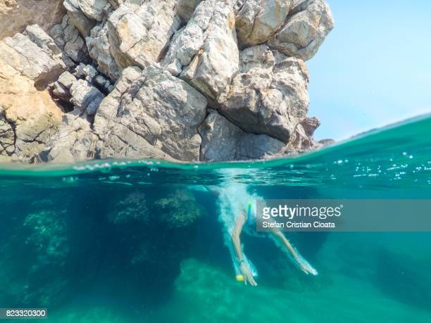 man diving into water in ionian sea, greece - mar jónico fotografías e imágenes de stock