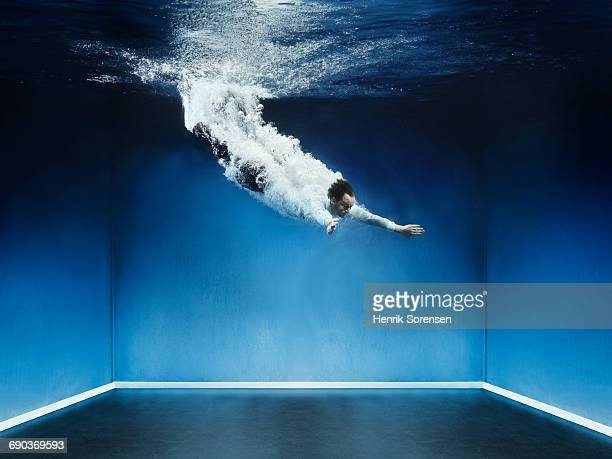 man diving into water - diving into water stock pictures, royalty-free photos & images