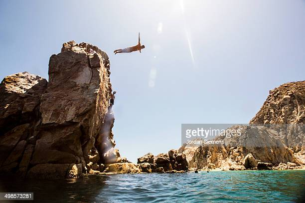A man diving off a cliff.