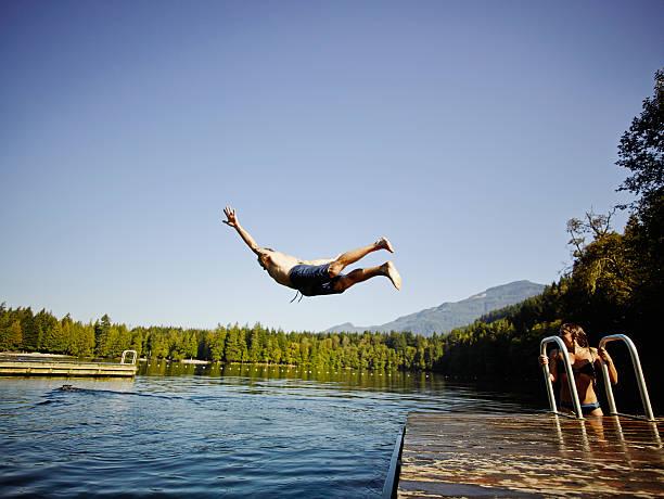Man Diving Off Dock Into Mountain Lake Wall Art