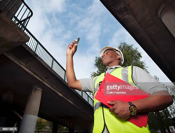 man documenting construction - colin hawkins stock pictures, royalty-free photos & images