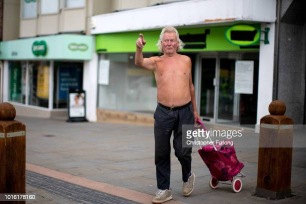 A man does his shopping in the centre of Dudley in the Black Country which was among the 29 out of 30 West Midlands voting areas to back the 'Leave'...