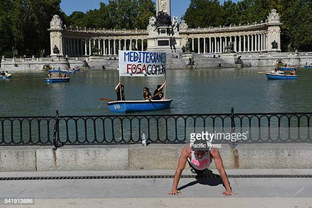 A man does pushups during a protest in Madrid in support of refugees and migrants An estimated 100 people gathered at 'Retiro' park in Madrid in...