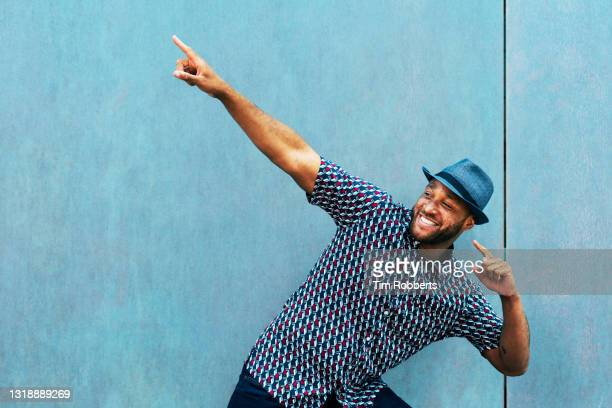 man doing a fun pointing gesture - success stock pictures, royalty-free photos & images