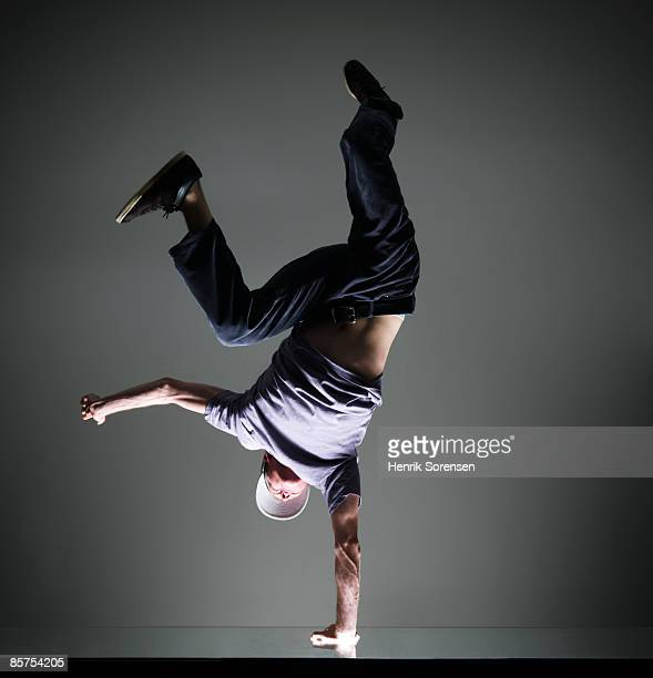 man doing a handstand on one hand - one man only stock pictures, royalty-free photos & images