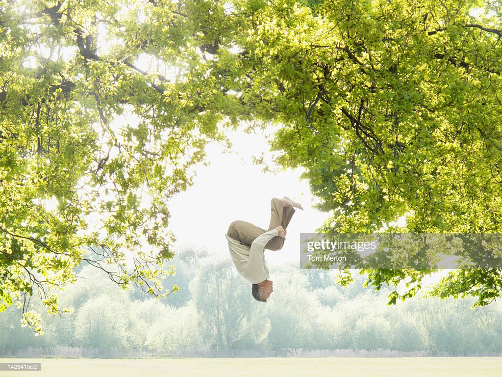 Man doing a somersault in the woods : Bildbanksbilder