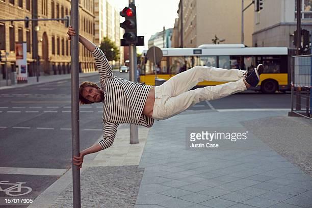 A man doing a tricky parkour move
