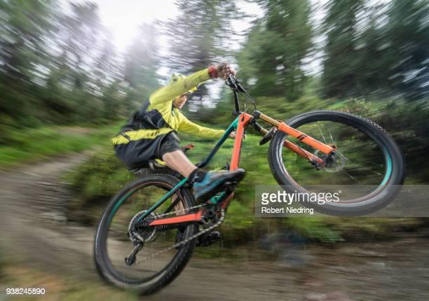 Man doing a wheelie with Mountain bike, Trentino-Alto Adige, Italy