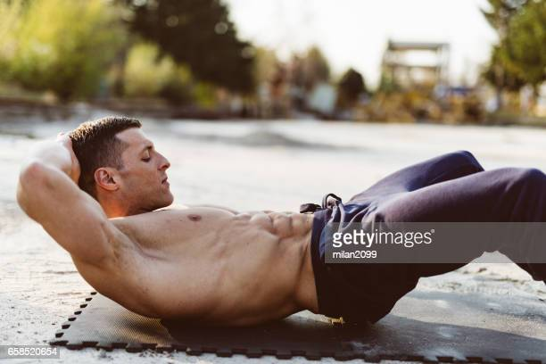 man doing abs exercise - abdominal muscle stock pictures, royalty-free photos & images