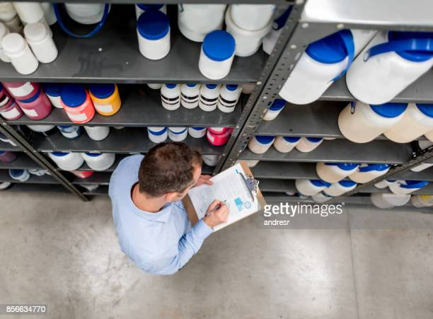 Man doing an inventory at a chemical warehouse