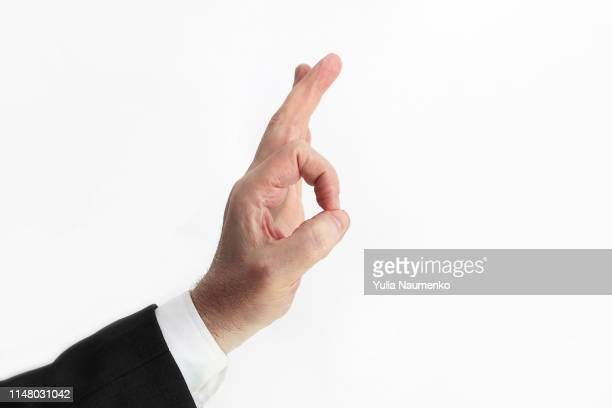 man doing an okay symbol. white background. - permission concept stock pictures, royalty-free photos & images