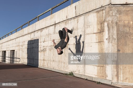 Man doing back flip while practicing parkour in the city