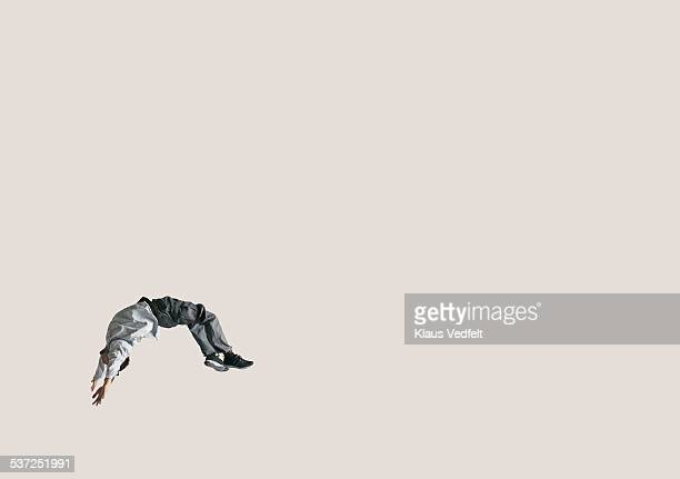 man doing backflip in the air, in large space - flexibility stock pictures, royalty-free photos & images