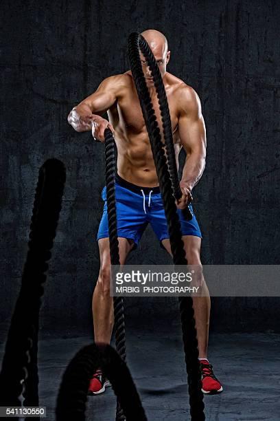 Man doing battle ropes exercise